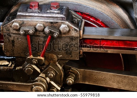 Detail of running gear of old steam engine - stock photo