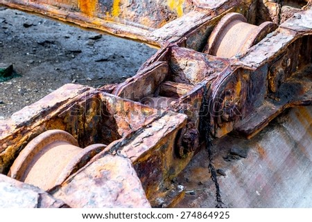 Detail of rusted wheels machinery of a old shipyard ramp disused - stock photo