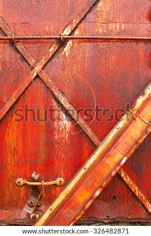 Detail of rusty red metal texture wet after recent rain