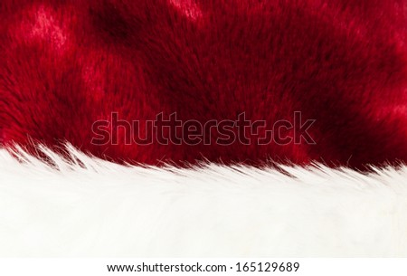 Detail Of Santa's Red and White Fur Hat Background Texture - stock photo