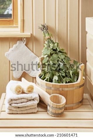 Detail of sauna interior with traditional sauna accessories  - stock photo