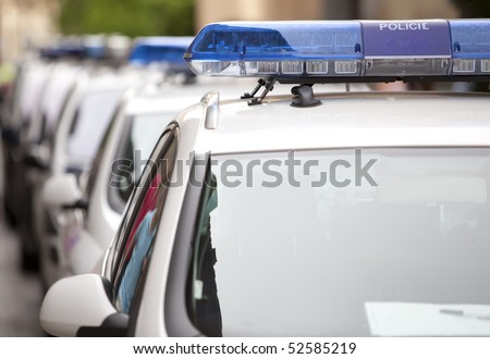 Detail of several police cars in a row, shallow deep of field. - stock photo
