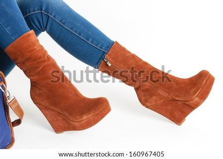 detail of sitting woman wearing fashionable platform brown shoes - stock photo