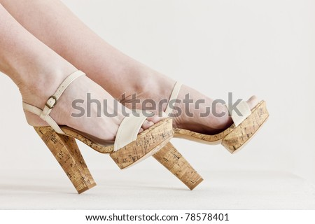 detail of sitting woman wearing summer shoes - stock photo