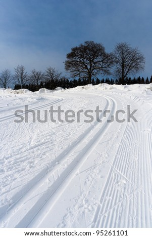 Detail of ski slope in the mountains - stock photo