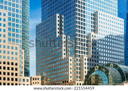 Detail of skyscrapers facade with windows in blue and yellow color - stock photo