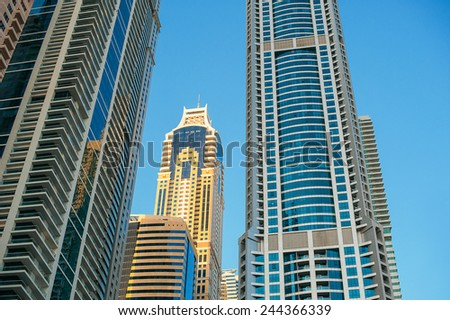 Detail of skyscrapers facade with windows in blue and yellow color. - stock photo