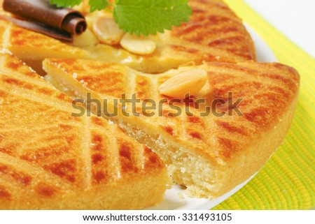 detail of sliced apple pie on white plate