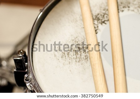 detail of snare drum and sticks - stock photo