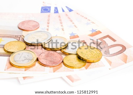 detail of some money euro coins and banknotes on white background - stock photo