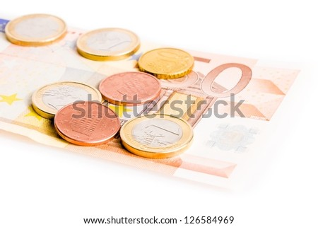 detail of some money euro coins on 50-euro banknote on white background - stock photo