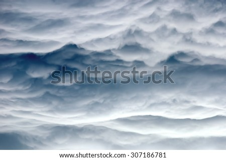 Detail of some structures and shapes of clouds building up during a thunderstorm. - stock photo