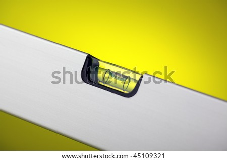 detail of spirit level with spot light on background - stock photo