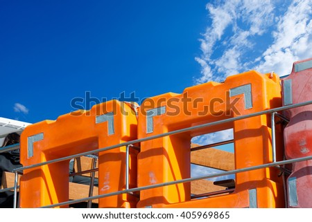 Detail of square lifebuoys for multiple people on the deck of a passenger ship - stock photo