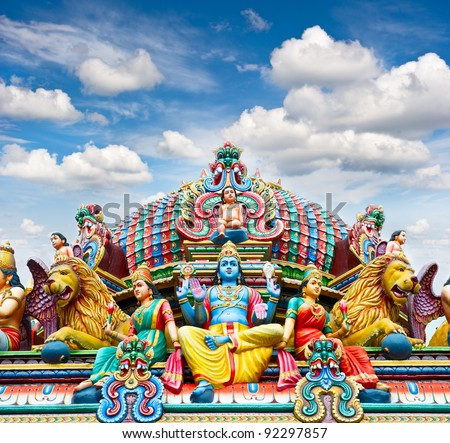 Detail of Sri Mariamman temple in Singapore over beautiful blue sky - stock photo