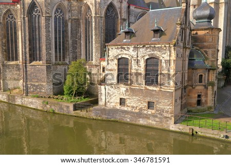 Detail of St Michael church o the side of a cal river in Ghent, Belgium
