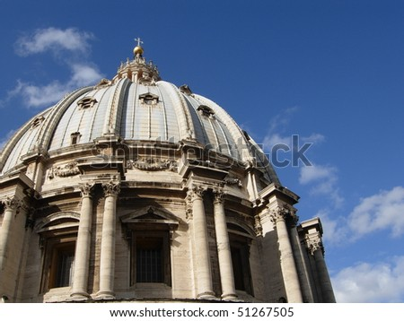 Detail of St Peter's dome in Vatican with blue sky - stock photo