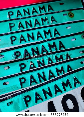 Detail of stack and row of Panama license plates for sale at market - stock photo