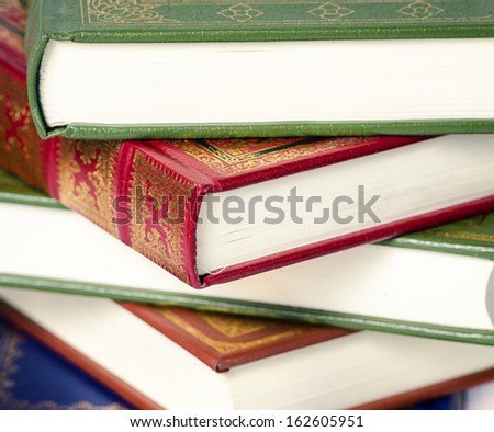 detail of stacked books of different colors