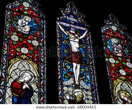 Detail of stained glass religious window in church Good Friday Easter - stock photo