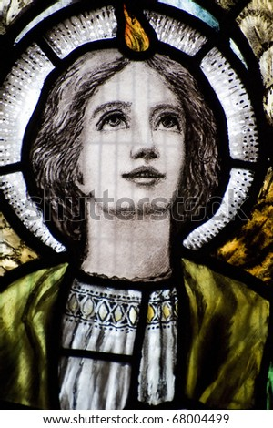 Detail of stained glass religious window in church Good Friday Easter