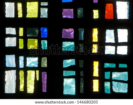 Detail of stained glass window made of chipped slab glass, located in chapel of Saint Benedict's Monastery in Winnipeg, Manitoba, Canada, designed by the late Gabriel Loire of Chartres, France - stock photo