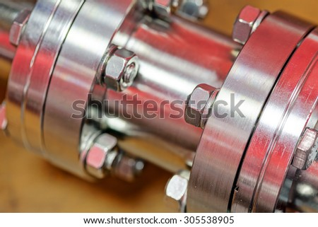 Detail of stainless steel machinery in physics laboratory