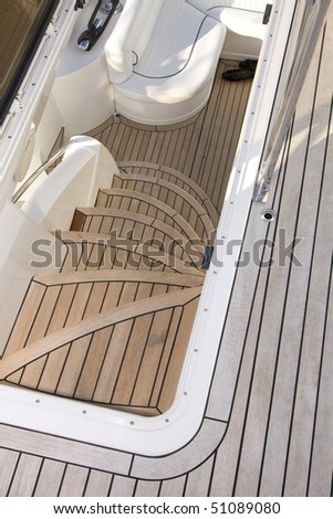 Detail of stairway to the fly bridge of a luxurious motorized yacht (Luxury concept) - stock photo