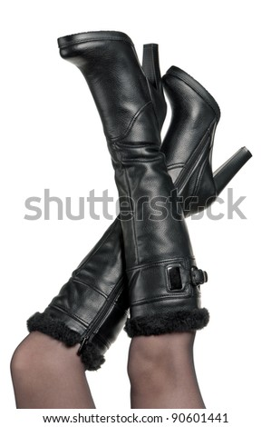 Detail of standing woman wearing fashionable black boots posing on white - stock photo