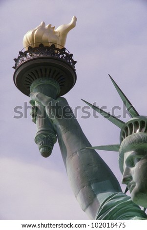 Detail of Statue of Liberty's arm holding torch - stock photo