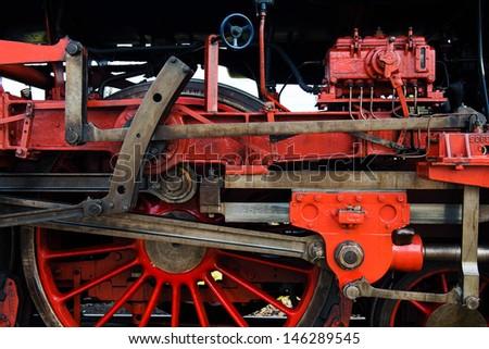 detail of steam locomotive wheel - stock photo