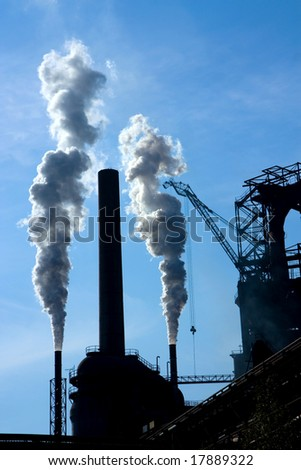 detail of steel factory and two chimneys - stock photo