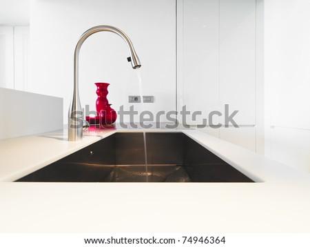 detail of steel tap in modern kitchen - stock photo