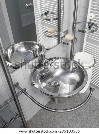 detail of steel washbasin in the modern bathroom - stock photo