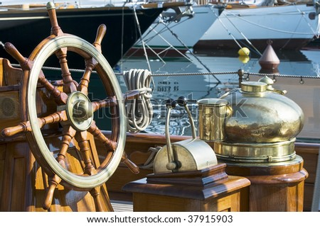 Detail of steering wheel and tools on a vessel - stock photo