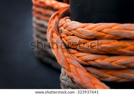 detail of strong orange rope on ship