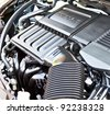 detail of sub compact car's gasoline engine - stock photo