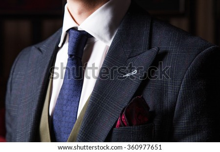 Detail of suited man - stock photo