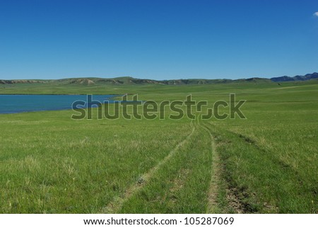 Detail of Sunshine reservoir with jeep trail, Wyoming - stock photo