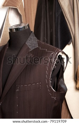 detail of tailors mannequin a Work in progres - stock photo