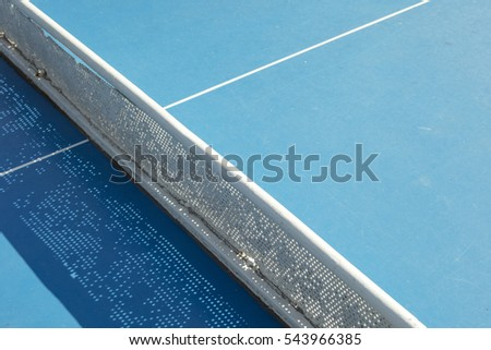 Detail of tennis table in Ciutadella park in Barcelona, on a sunny day.