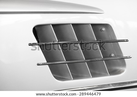 Detail of the air intake of a sports car - stock photo