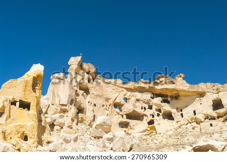Detail of the ancient castle of Cavusin dug from a mountains, Cappadocia, Turkey - stock photo