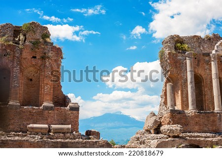 Detail of the ancient greek amphitheatre with the Etna Volcano in Taormina city, Sicily island, Italy - stock photo