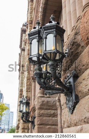 Detail of the architecture of the old city hall in Toronto: a beautiful exterior lamp - stock photo