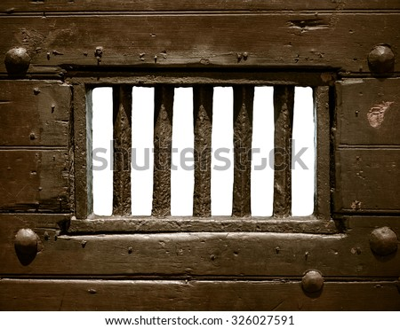 Detail Of The Bars Of An Old Prison Or Jail Cell Door - stock photo