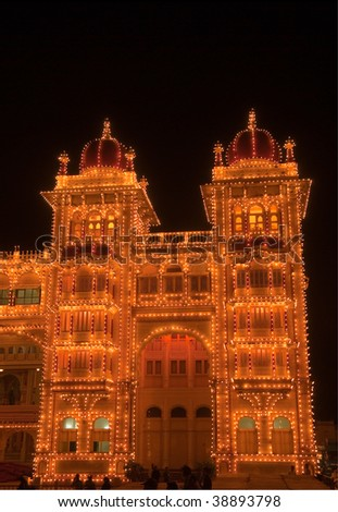 Detail of the beautiful Mysore Palace, India lit up during the Dasara festival - stock photo
