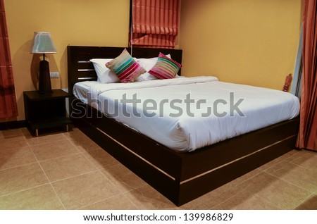Detail of the bed in bedroom - stock photo