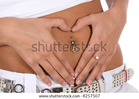 Detail of the belly of a young woman, wearing a navel piercing - stock photo