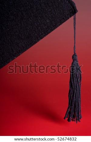 Detail of the black tassel of a graduation cap - stock photo